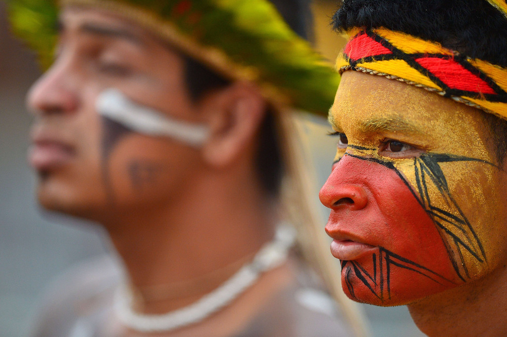 . A Brazilian indigenous man of the Pataxo tribe waits to take part in the bow and arrow competition during the XII International Games of Indigenous Peoples in Cuiaba, Mato Grosso state, Brazil on November 12, 2013. AFP PHOTO / Christophe SIMON/AFP/Getty Images