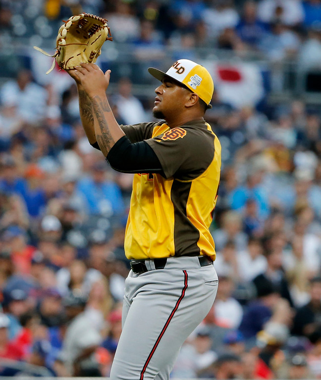 . World Team pitcher Adalberto Mejia, of the San Francisco Giants celebrates their 11-3 win against the U.S. Team after the All-Star Futures baseball game, Sunday, July 10, 2016, in San Diego. (AP Photo/Lenny Ignelzi)