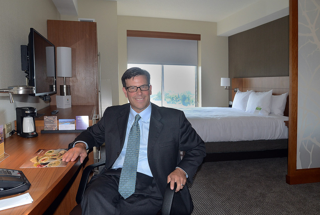 . Blair Bowman, owner of the Suburban Collection Showplace in Novi, in one of the rooms at the new Hyatt Place hotel he owns that is connected to the Showplace, during their grand opening today, Tuesday August 20, 2013. (Oakland Press Photo:Vaughn Gurganian)