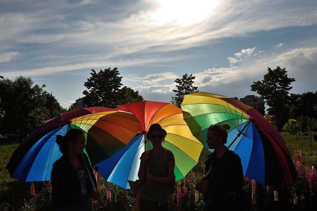 . People hold raibow umbrellas to celebrate International Day Against Homophobia in the front of the Romanian Parliament building in Bucharest May 17, 2016.  The International Day Against Homophobia, Transphobia and Biphobia (IDAHO) is observed on May 17 and aims to coordinate international events that raise awareness of LGBT rights violations and stimulate interest in LGBT rights work worldwide.  / AFP PHOTO / DANIEL  MIHAILESCU/AFP/Getty Images