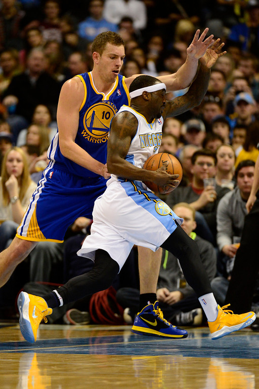 . Denver Nuggets point guard Ty Lawson (3) drives past Golden State Warriors power forward David Lee (10) during the second half of the Nuggets\' 116-105 win at the Pepsi Center on Sunday, January 13, 2013. AAron Ontiveroz, The Denver Post