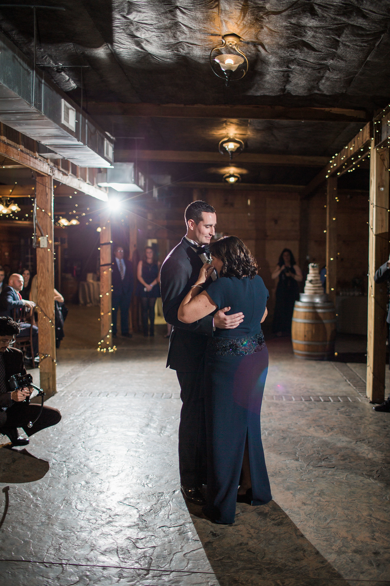Kyle's mother son dance at his Bluemont Vineyards wedding. Photos by the best Washington DC wedding photographer Jalapeno Photography.