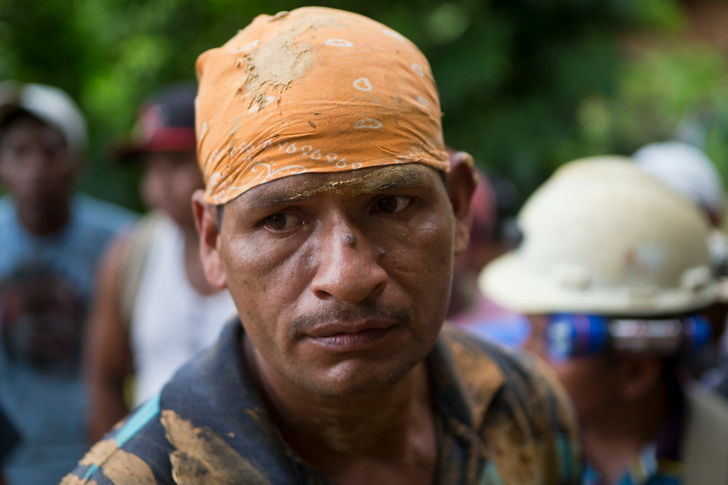 . A miner rests after taking part in the rescue operation of the miners trapped at El Comal gold and silver mine after a landslide trapped at least 24 miners inside, in Bonanza, Nicaragua, Friday, Aug. 29, 2014. Rescuers on Friday located 20 of at least 24 gold miners trapped by a landslide in northern Nicaragua, but were not immediately able to bring them to safety. (AP Photo/Esteban Felix)
