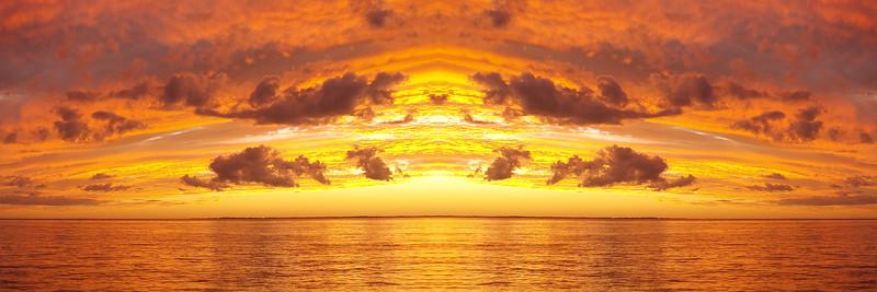 Orange and gold coloured Cirrus and Cumulus cloudy coastal Sunset Seascape. Australia