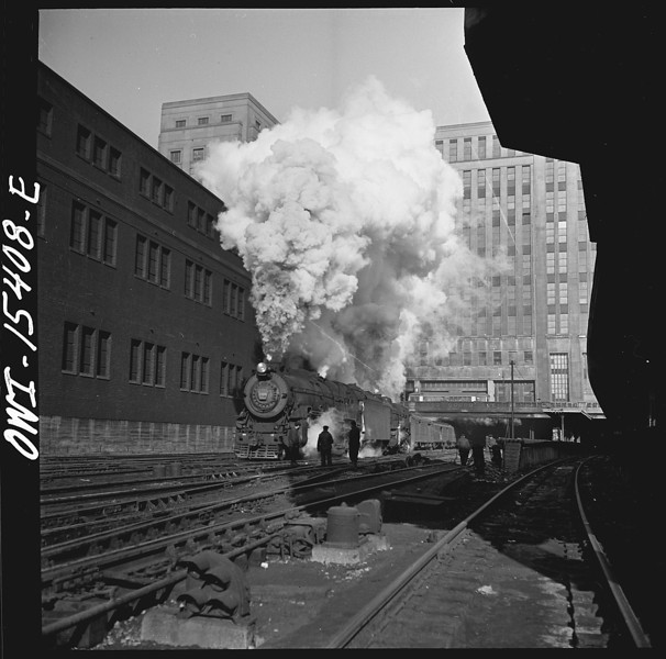 Title: Chicago, Illinois. Double header Pennsylvania railroad train pulling out of Union station. The building in the background is the United States Post Office Creator(s): Delano, Jack, photographer Date Created/Published: 1943 Jan.   http://www.loc.gov/pictures/item/owi2001017486/PP/