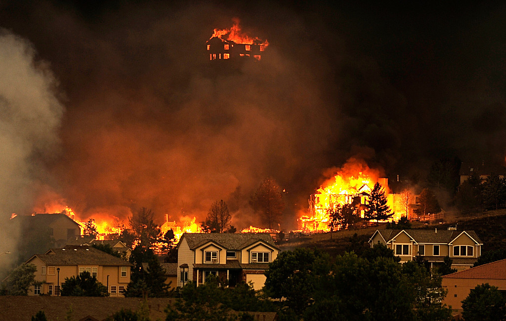 . The Waldo Canyon Fire raced out of the mountains and into a Colorado Springs subdivision, burning out of control, Tuesday, June 26, 2012. RJ Sangosti, The Denver Post