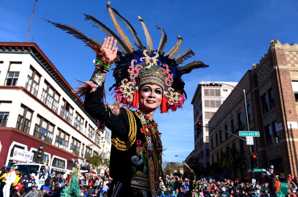 ". Yohgues Nyowan Suko Utomo waves to the crowd as he walks along Republic of Indonesia\'s Ministry of Tourism ""Wonderful Indonesia\"" float as it heads down Colorado Boulevard during the 125th Rose Parade in Pasadena, CA January 1, 2014. (Photo by Sarah Reingewirtz/Pasadena Star-News)"
