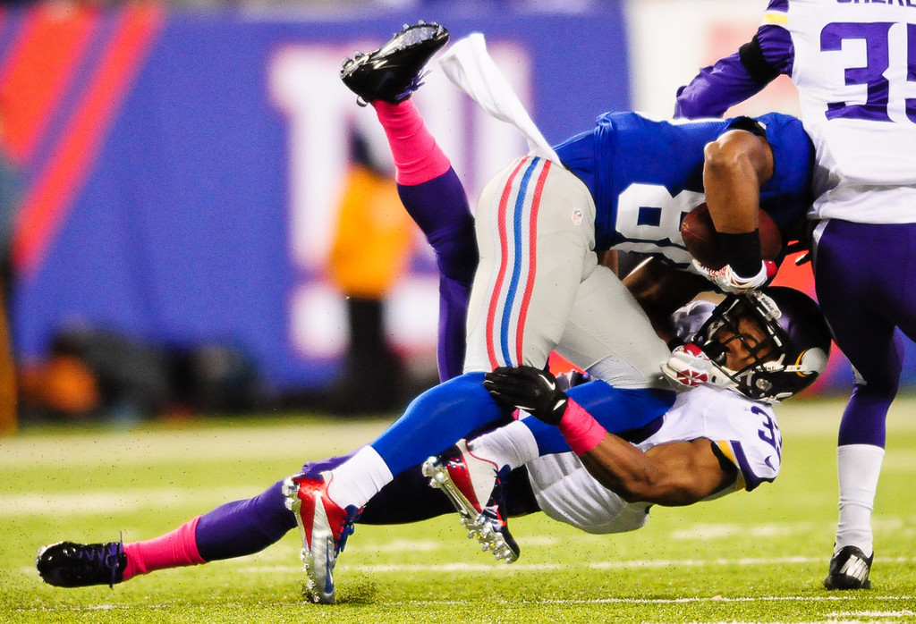. Giants wide receiver Victor Cruz blows over Vikings strong safety Jamarca Sanford for a first down in the second quarter.  (Pioneer Press: Ben Garvin)