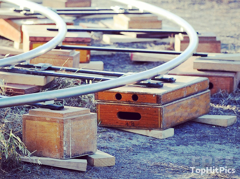 A Wooden Film Set Rail Box With A Funny Face