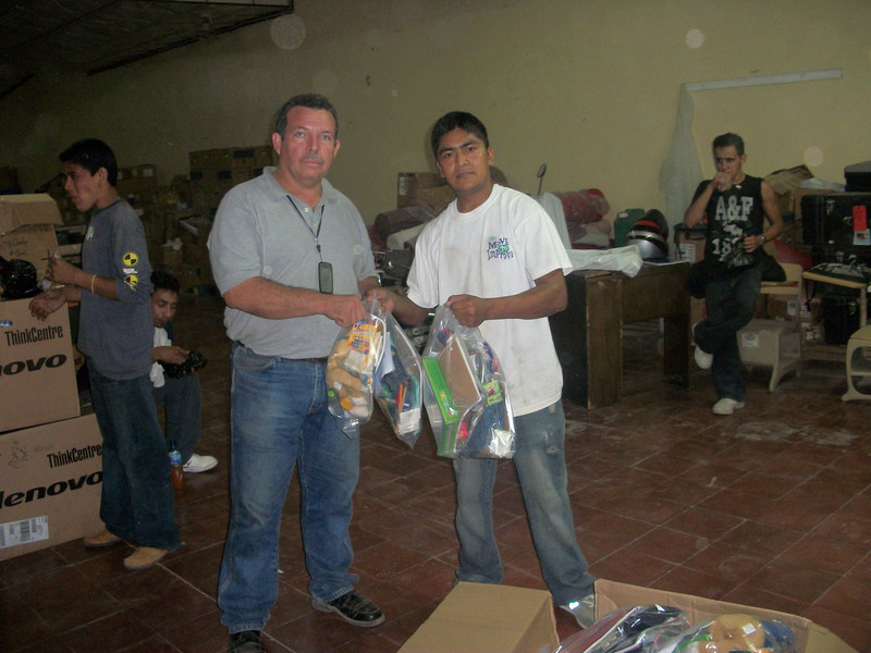 First distribution of Smile boxes in 2009.  Marwell, our mission worker in charge of Smile box distribution for the past 2 years, gives Roberto the boxes he will take back to his church in Managua.