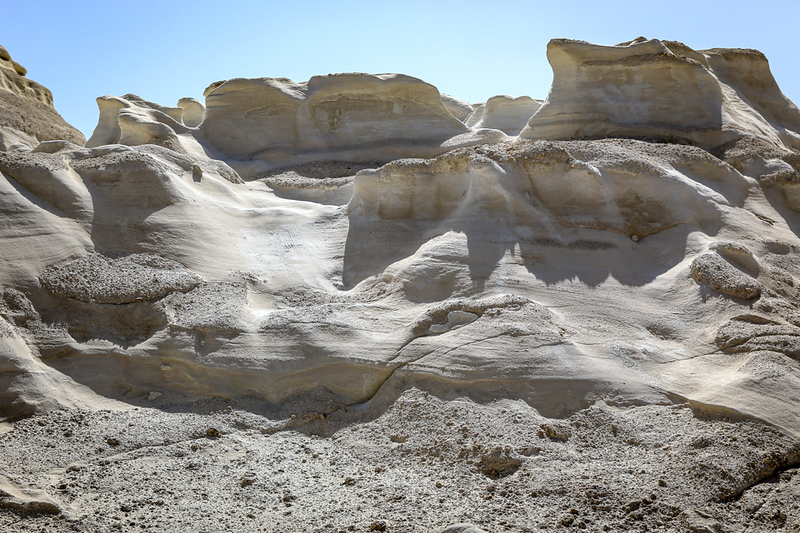 You'll see a white dunes landscape on Milos during a cruise in the Greek Islands