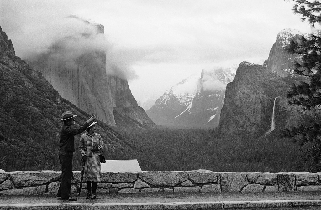 . Park superintendent Bob Binnewies points out highlights from Inspiration Point to Queen Elizabeth II during her visit on Saturday, March 5, 1983 in Yosemite National Park, in California. (AP Photo/Walt Zeboski)