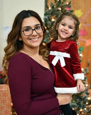 12/7/2019 Mike Orazzi | StaffrElenitsa Monagas and her daughter Sophia Ayala,2, during the YWCA of New Britain Winter Wonderland on Saturday in New Britain.