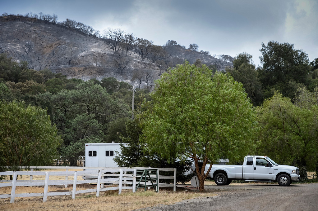 . Horse trailers return with horses in Hidden Valley Sunday.  Cool damp weather has helped crews begin to get the upper hand on the fire which has burned more than 10,000 acres.  Photo by David Crane/Los Angeles Daily News.
