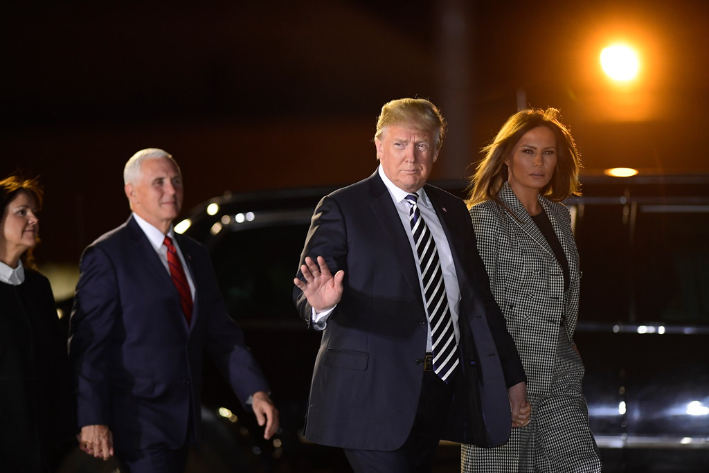 . First lady Melania Trump, from right, President Donald Trump, Vice President Mike Pence and his wife Karen Pence arrive at Andrews Air Force Base in Md. to greet three Americans freed from captivity in North Korea, Thursday, May 10, 2018. (AP Photo/Susan Walsh)