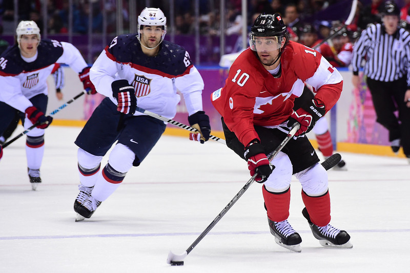 . Canada\'s Patrick Sharp (R) controls the puck during the Men\'s Ice Hockey Semifinals USA vs Canada at the Bolshoy Ice Dome during the Sochi Winter Olympics on February 21, 2014.    JOHN MACDOUGALL/AFP/Getty Images