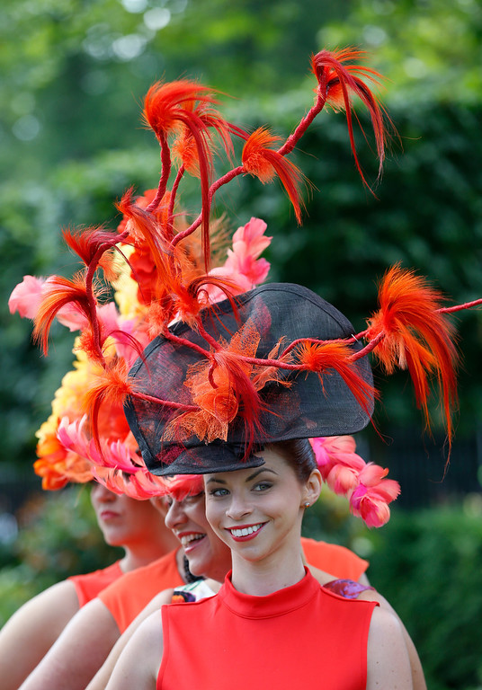. Linzi Weare , foreground, and friends pose for a photograph,  on the first day of the Royal Ascot horse racing meeting at Ascot, England, Tuesday, June 17, 2014.  (AP Photo/Alastair Grant)