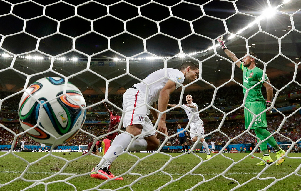 . United States\' Clint Dempsey, scores his side\'s second goal during the group G World Cup soccer match between the USA and Portugal at the Arena da Amazonia in Manaus, Brazil, Sunday, June 22, 2014. (AP Photo/Julio Cortez)