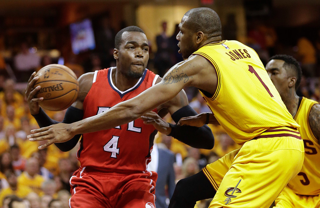 . Atlanta Hawks forward Paul Millsap (4) looks to pass against Cleveland Cavaliers forward James Jones (1) in the first quarter of Game 4 of the NBA basketball Eastern Conference Finals, Tuesday, May 26, 2015, in Cleveland. (AP Photo/Tony Dejak)