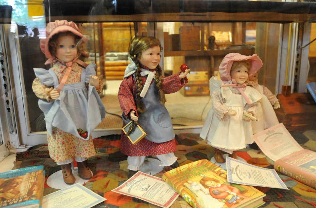 ". Limited edition dolls made by The Ashton-Drake Galleries, not for sale are displayed at the Little House Wayside Museum in Pepin, Wisconsin.  The books by Laura Ingalls Wilder helped make the region famous. Sisters represented are from left: Mary, Laura and Carrie Ingalls. About 7 miles up the road from the Museum is a replica of ""Little House in the Big Woods\"" one of the many homes that Laura wrote about in her series of books for children. (Pioneer Press: Ginger Pinson)"