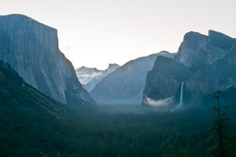 After finally making my first trip to Tunnel View the night before my friend Zack and I woke up before 5am to try to get sunrise at Tunnel View. We got there by 5:20 (sunrise wasn't until ~5:50) but we didn't get the light we wanted again. Instead, the sky was just completely blown out. There was one guy who had 3 graduated neutral density filters on and he said the sky was *still* blown out! There were some neat cloud/fog formations though in the valley. It was a gorgeous sunrise!