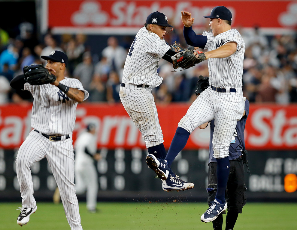 . The New York Yankees celebrate after beating the Cleveland Indians 1-0 in Game 3 of baseball\'s American League Division Series, Sunday, Oct. 8, 2017, in New York. (AP Photo/Kathy Willens)