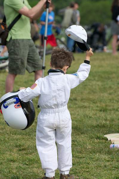 Boy waving is hat at the shuttle....