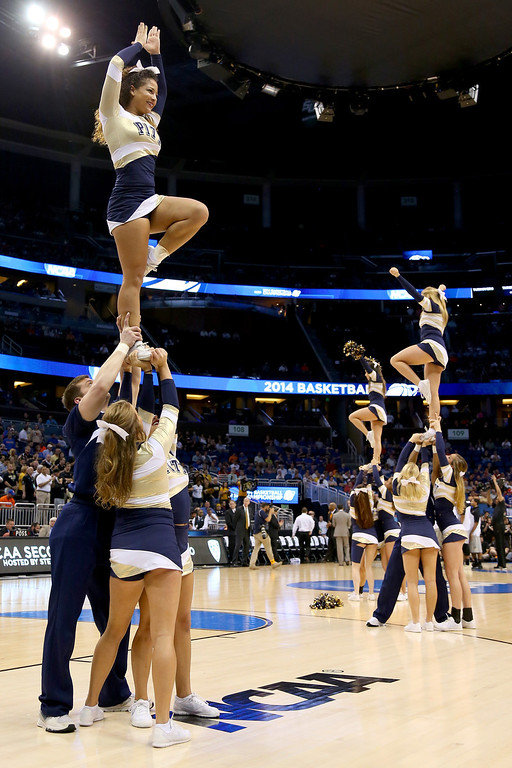 . Pittsburgh Panthers cheerleaders perform during a break in the game against the Colorado Buffaloes in the second round of the 2014 NCAA Men\'s Basketball Tournament at Amway Center on March 20, 2014 in Orlando, Florida.  (Photo by Mike Ehrmann/Getty Images)