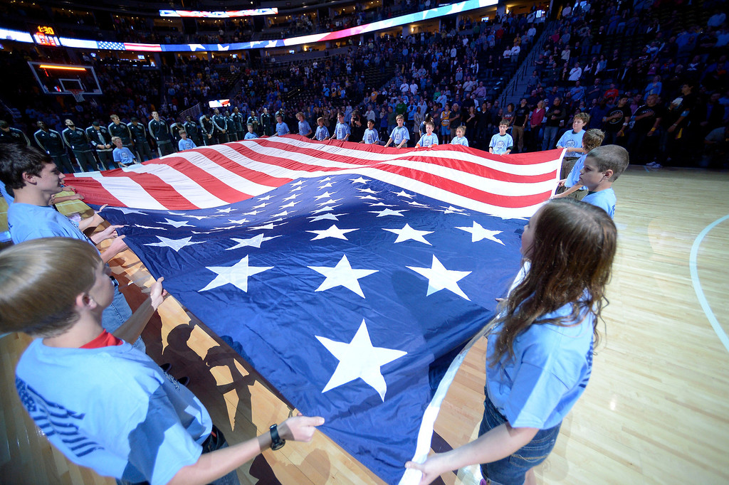. A flag was displayed for the national anthem prior to the game between the Denver Nuggets and the San Antonio Spurs October 14, 2013 at Pepsi Center. (Photo By John Leyba/The Denver Post)