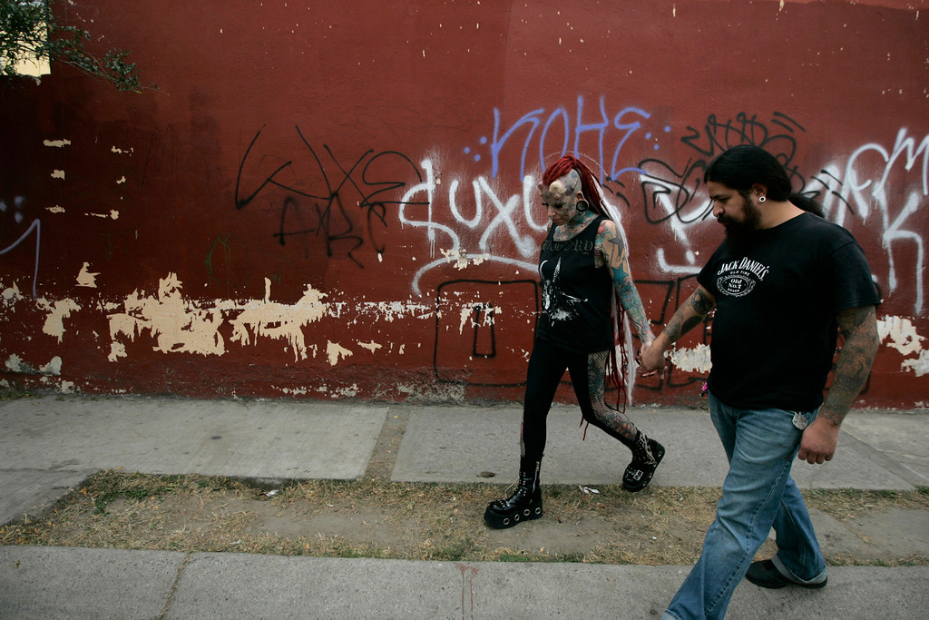 . Maria Jose Cristerna walks hand in hand with her partner David Pena on their way to pick up her children from school in Guadalajara February 7, 2012.REUTERS/Alejandro Acosta
