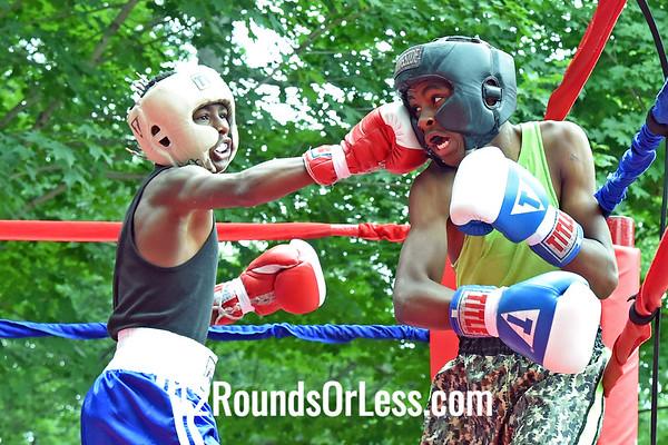 Bout 1:  Reginald Riggins, Red Gloves, 110 lbs -vs- Gordon Kirkland, Blue Gloves, 117 lbs