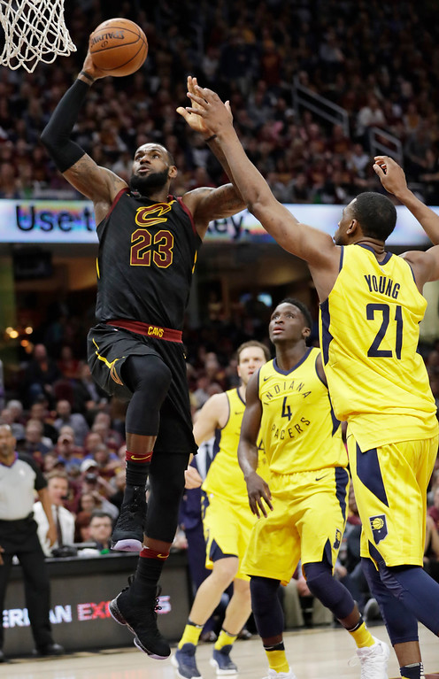 . Cleveland Cavaliers\' LeBron James (23) drives to the basket against Indiana Pacers\' Thaddeus Young (21) in the first half of Game 5 of an NBA basketball first-round playoff series, Wednesday, April 25, 2018, in Cleveland. (AP Photo/Tony Dejak)