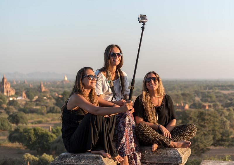 Tourists take selfie atop temple in Bagan, Burma - Myanmar