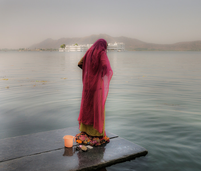 Many of the old houses in Udaipur lack running water. For this reason many local women head down to the lake at sunrise and sunset to wash themselves and do the laundry.  Udaipur, Rajasthan, India, 2011.