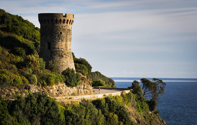 Riding past the Tour de l'ouse, Cap Corse, Corsica, France