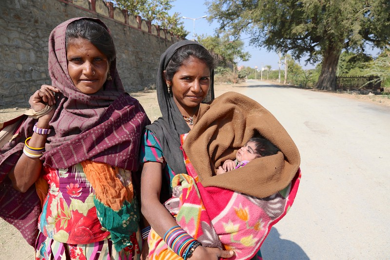 We saw these 2 women walking along this quiet road and they called over to us so that they could show us the baby. This was common, that women would call us over and want us to see their little ones.