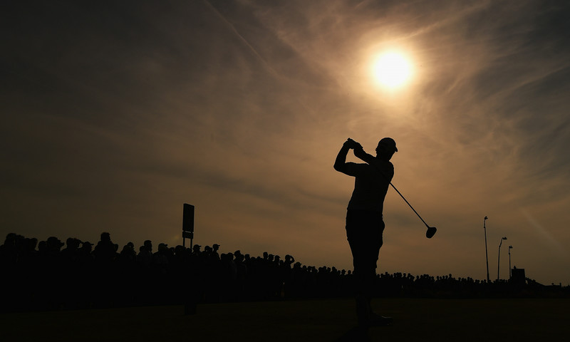 . (EDITORS NOTE: A GRADUATED FILTER WAS USED IN THE CREATION OF THIS IMAGE) Adam Scott of Australia tees off on the 13th hole during the first round of The 143rd Open Championship at Royal Liverpool on July 17, 2014 in Hoylake, England.  (Photo by Stuart Franklin/Getty Images)