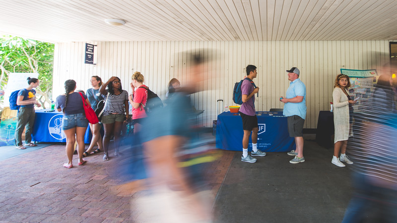 Campus organizations set up in the breezeway to interact with students.