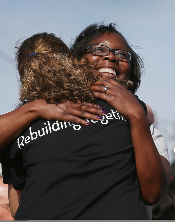. During the remembrance ceremony for the victims of last year\'s tornado, Alecia Nicholson is hugged on May 20, 2014 in Moore, Oklahoma.  On May 20, 2013 a two-mile wide EF5 tornado touched down in the town killing 24 people and leaving behind extensive damage to homes and businesses.  (Photo by Joe Raedle/Getty Images)