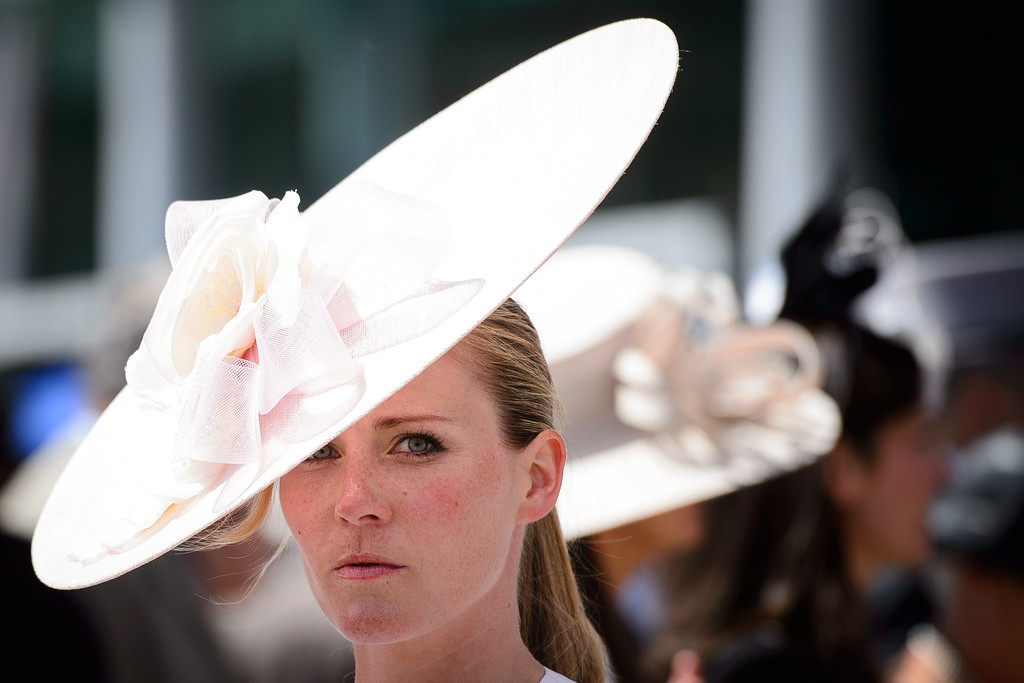 . A racegoer looks on near the Parade Ring at Royal Ascot, in Berkshire, west of London, on June 17, 2014. AFP PHOTO / LEON NEAL/AFP/Getty Images