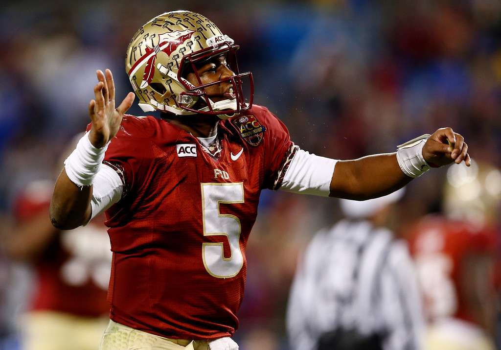 . Quarterback Jameis Winston #5 of the Florida State Seminoles reacts against the Duke Blue Devils during the ACC Championship game at Bank of America Stadium on December 7, 2013 in Charlotte, North Carolina.  (Photo by Streeter Lecka/Getty Images)