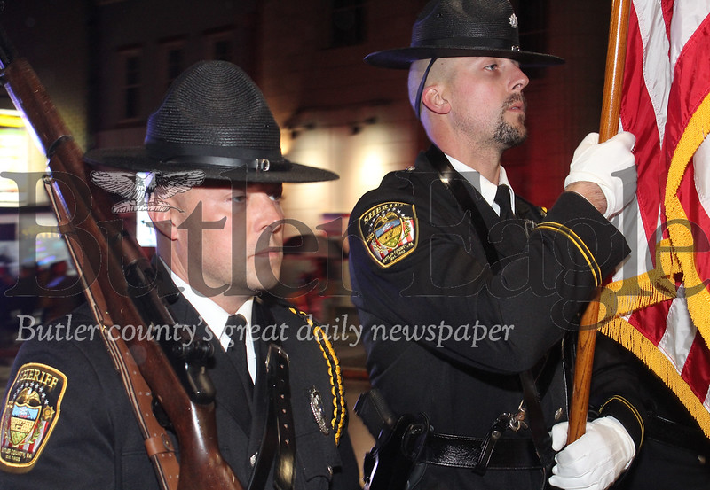 Harold Aughton/Special to the Eagle: Members of the Butler County Sheriff's department let the parade carrying the American flag Saturday evening during the annual Butler Christmas parade.