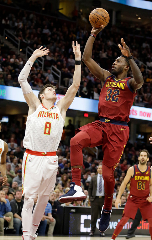 . Cleveland Cavaliers\' Jeff Green (32) shoots over Atlanta Hawks\' Luke Babbitt (8) in the second half of an NBA basketball game, Tuesday, Dec. 12, 2017, in Cleveland. The Cavaliers won 123-114. (AP Photo/Tony Dejak)