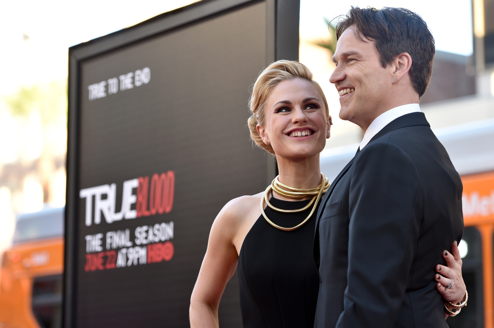 Description of . Anna Paquin, left, and Stephen Moyer arrive at the Los Angeles premiere of the 7th and final season of