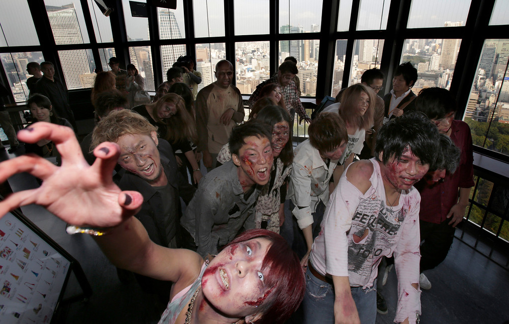 . Participants wearing zombie makeups perform during a Halloween event at Tokyo Tower in Tokyo, Thursday, Oct. 31, 2013. (AP Photo/Shizuo Kambayashi)