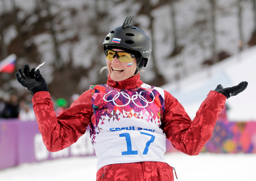 . Russia\'s Assoli Slivets reacts after a jump during the women\'s freestyle skiing aerials qualifying at the Rosa Khutor Extreme Park, at the 2014 Winter Olympics, Friday, Feb. 14, 2014, in Krasnaya Polyana, Russia. (AP Photo/Andy Wong)