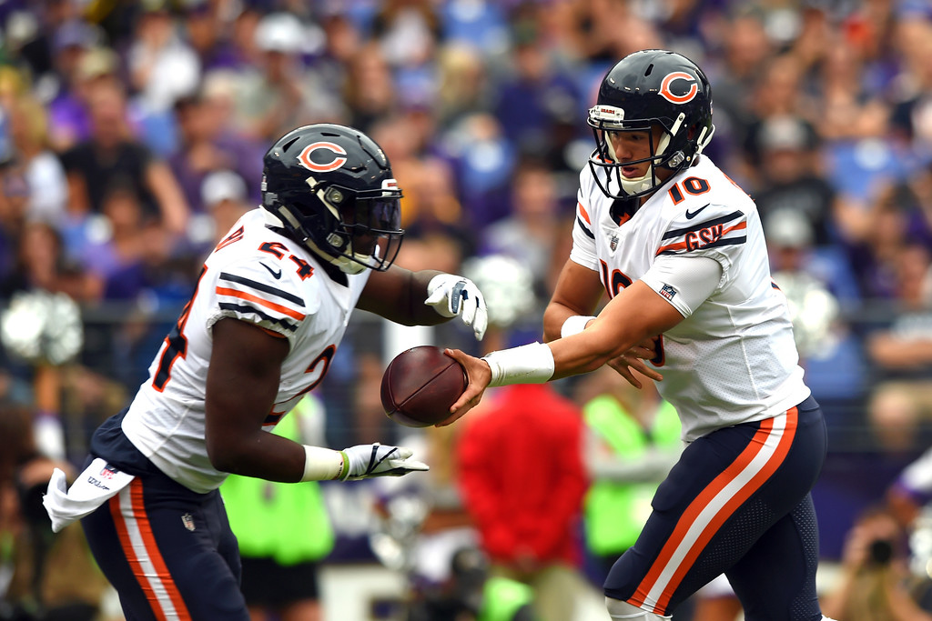 . Chicago Bears quarterback Mitchell Trubisky, right, hands off to running back Jordan Howard in the first half of an NFL football game, Sunday, Oct. 15, 2017, in Baltimore. (AP Photo/Gail Burton)