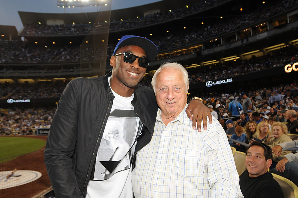 . Kobe Bryant of the Los Angeles Lakers and Tommy Lasorda  attend a game between the Los Angeles Dodgers and the New York Yankees on July 31, 2013 at Dodger Stadium in Los Angeles, Caifornia. (Photo by Jill Weisledero/Los Angeles Dodgers via Getty Images)
