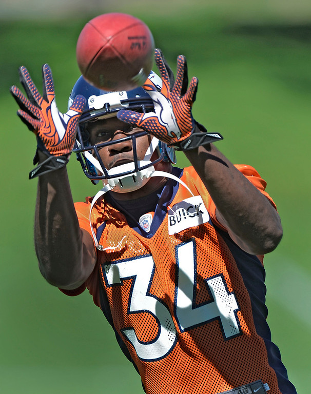 . Denver Broncos Quentin Jammer (34) goes up for a pass during OTA\'s May 30, 2013 at Dove Valley. (Photo By John Leyba/The Denver Post)