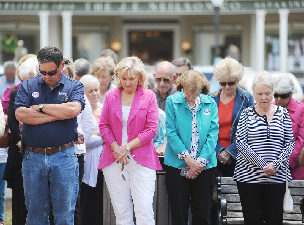 . People bow their heads during a prayer as the National Day of Prayer as the National Day of Prayer is celebrated in Oxford, Miss. on Thursday, May 1, 2014.  (AP Photo/Oxford Eagle, Bruce Newman)